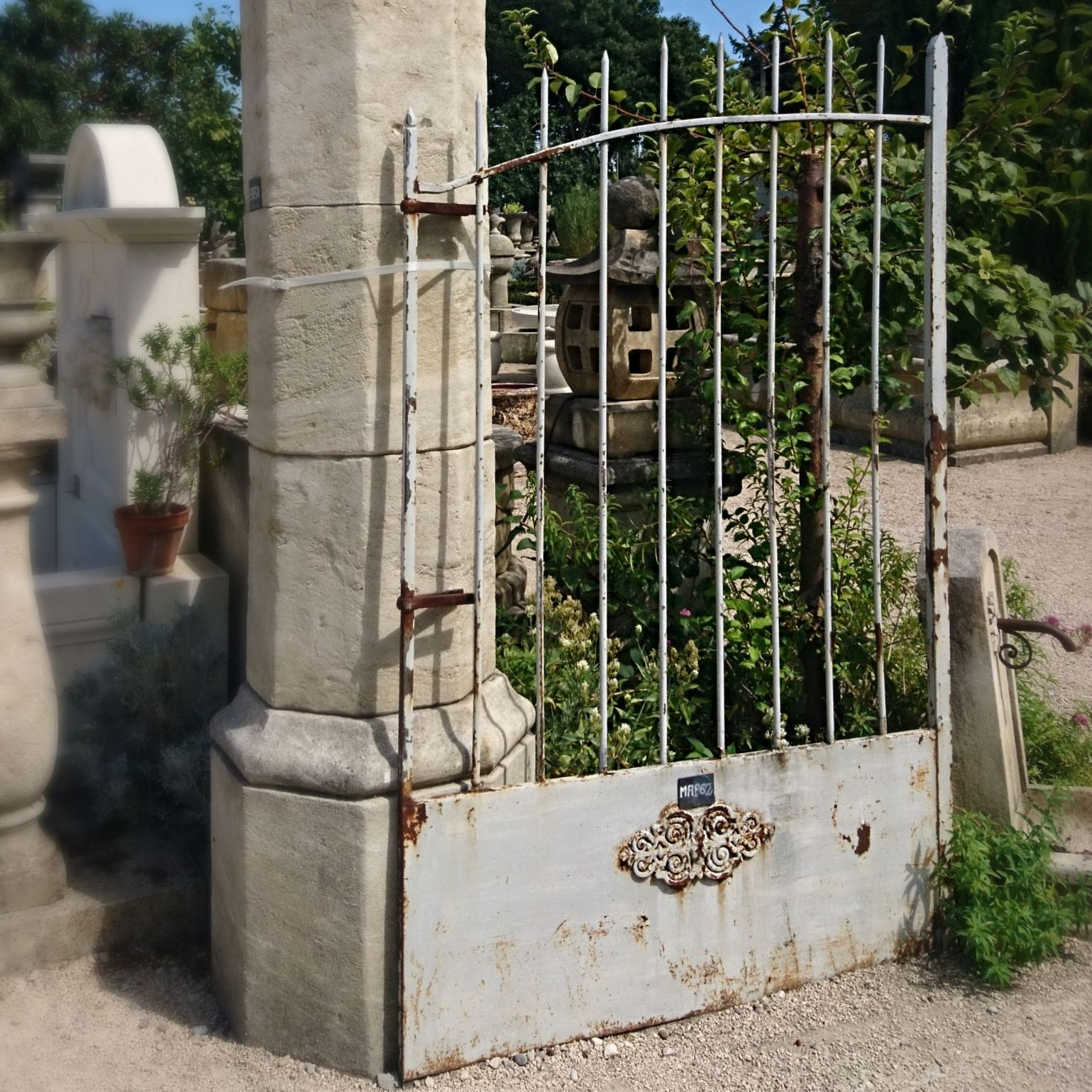 Antique gate made with finesse and harmony - an elegant wrought iron gate, to be placed at the entrance of a house.