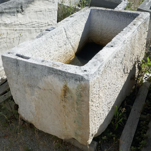 Antique decorative stone planter for the garden - rectangular hard stone trough.