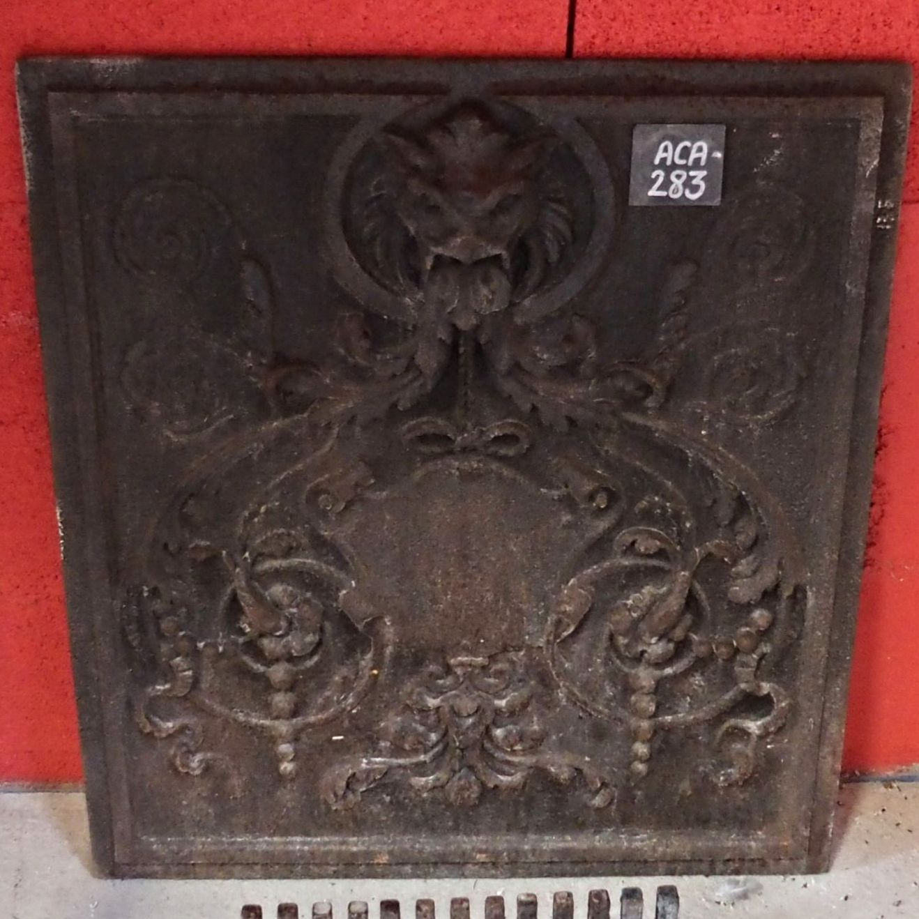Beautiful cast iron fireback - old cast iron fireplace accessories.