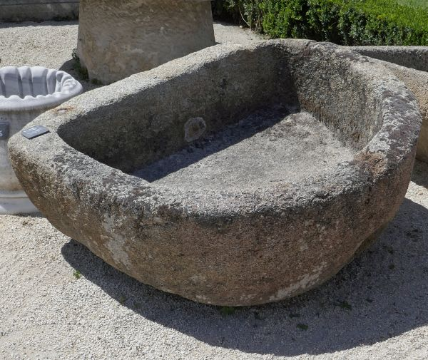 Large antique granite trough - Massive stone trough as outdoor ornament.