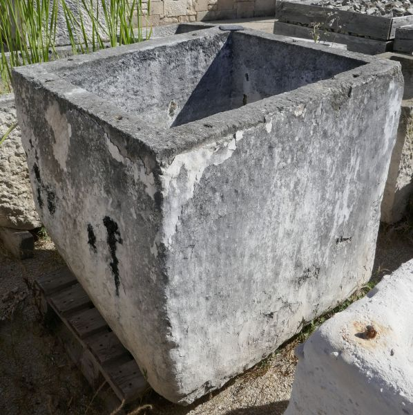 Large and beautiful old square-shaped stone trough.