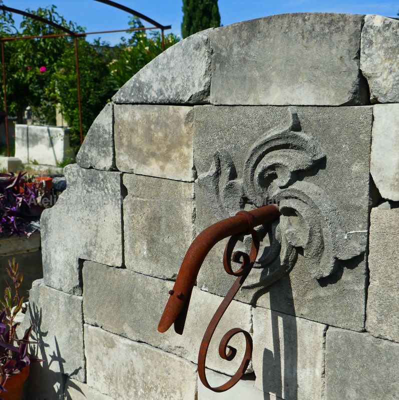 Antique garden wall fountain in stone by Alain BIDAL Antique Materials in Provence